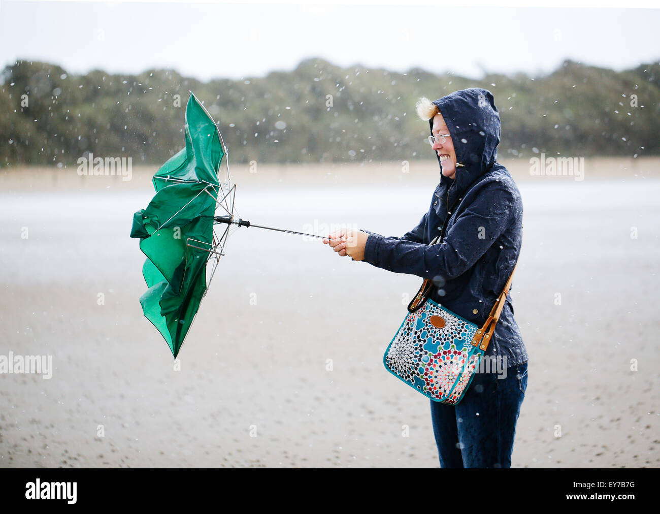 a-woman-holding-an-umbrella-which-has-bl