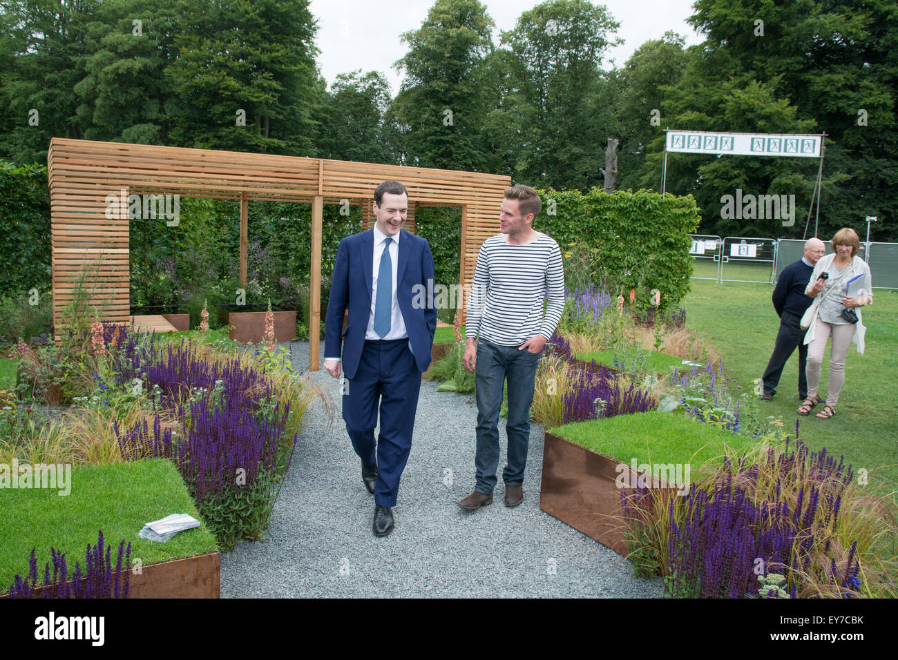 Tatton Park, Cheshire, UK. 23rd July 2015. Chancellor George Osborne at the RHS flower show, with young designer - Stock Image