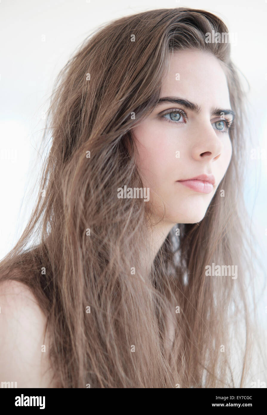 Portrait of young woman with blue eyes - Stock Image