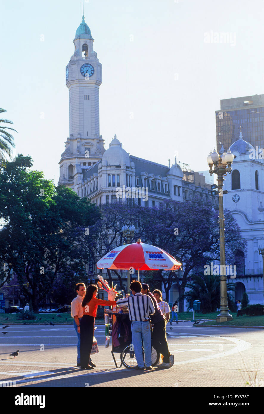 The Cabildo and Clock Tower at Plaza de Mayo with people on square buying ice cream in Buenos Aires - Stock Image