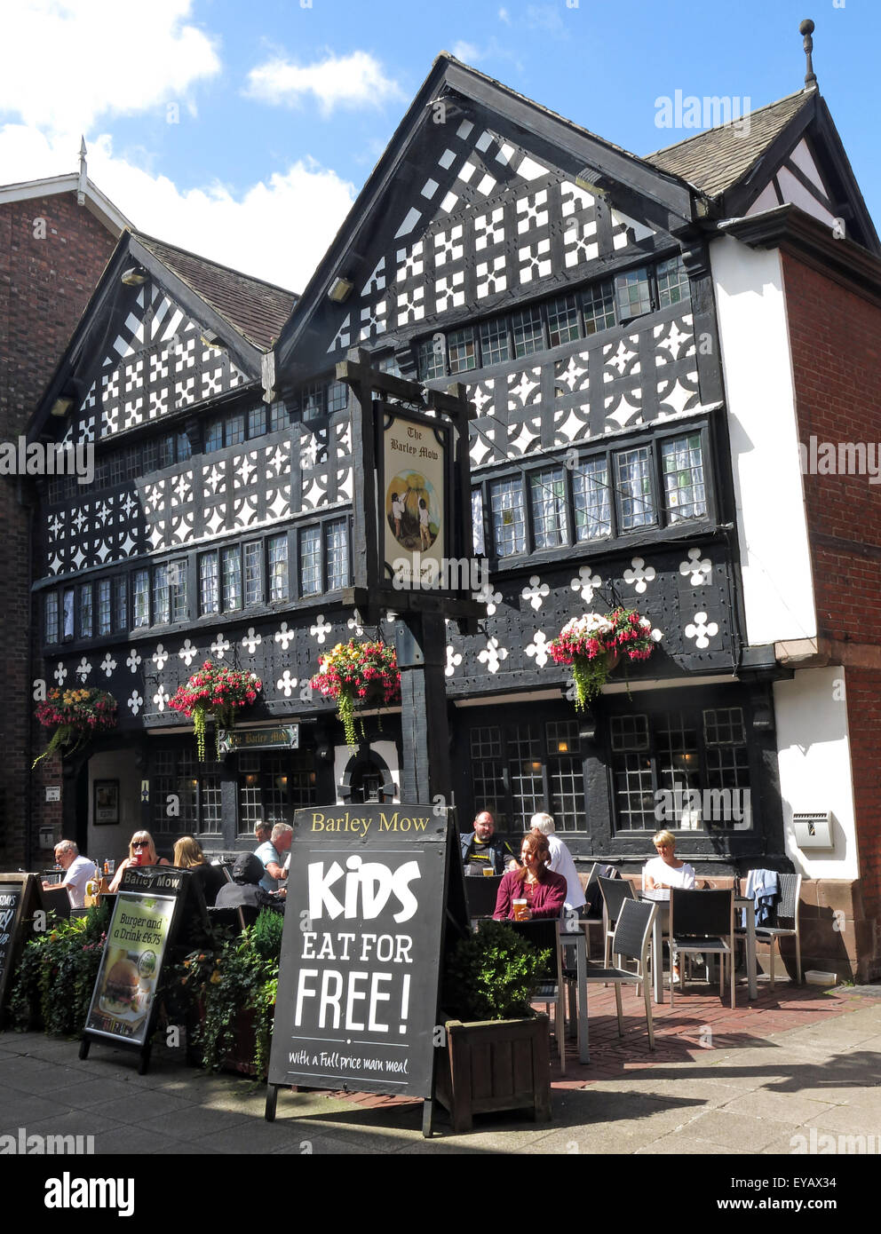 oldest,bar,united,kingdom,GB,Great Britain,history,historic,pint,beer,bitter,drink,drinkers,with,Square,Marketplace,Timber,Framed,Tudor,Cheshire,England,UK,listed,building,I,Grade1,one,timber-framed,public,house,black,white,quatrefoils,red,sandstone,plinth,jettied,gable,Golden Square,Grade One,GoTonySmith,tavern,pubsign,sign,BarleyMow,WA1,WBC,Borough,Council,wood,wooden,Portrait,Buy Pictures of,Buy Images Of,Market Place,Kids eat Free,Barley Mow Public House,Grade2 Listed