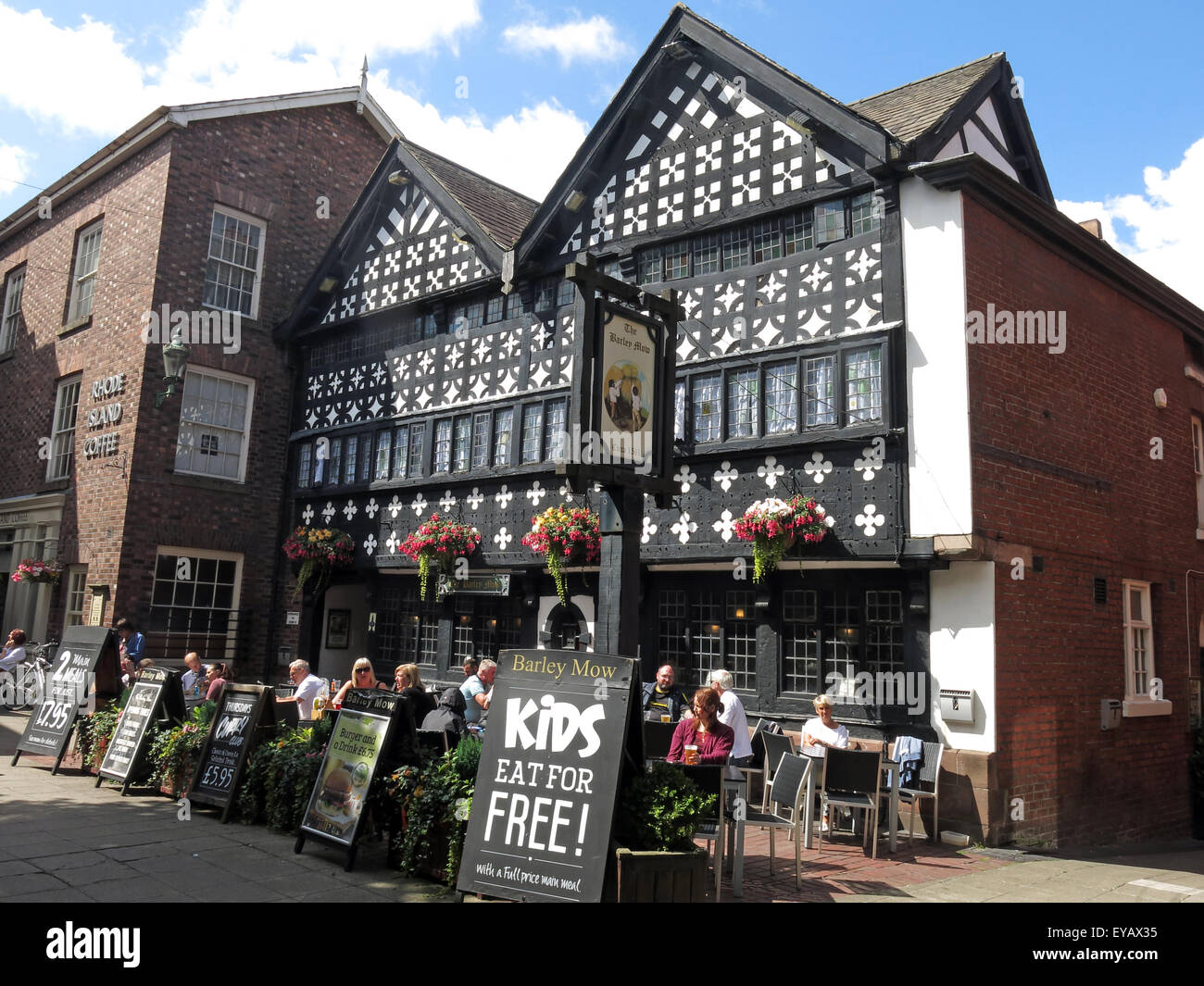oldest,bar,united,kingdom,GB,Great Britain,history,historic,pint,beer,bitter,drink,drinkers,with,Square,Marketplace,Timber,Framed,Tudor,Cheshire,England,UK,listed,building,I,Grade1,one,timber-framed,public,house,black,white,quatrefoils,red,sandstone,plinth,jettied,gable,Golden Square,Grade One,GoTonySmith,tavern,pubsign,sign,BarleyMow,WA1,WBC,Borough,Council,wood,wooden,Landscape,Buy Pictures of,Buy Images Of,Market Place,Kids eat Free,Barley,Mow,Public,House,Grade2 Listed