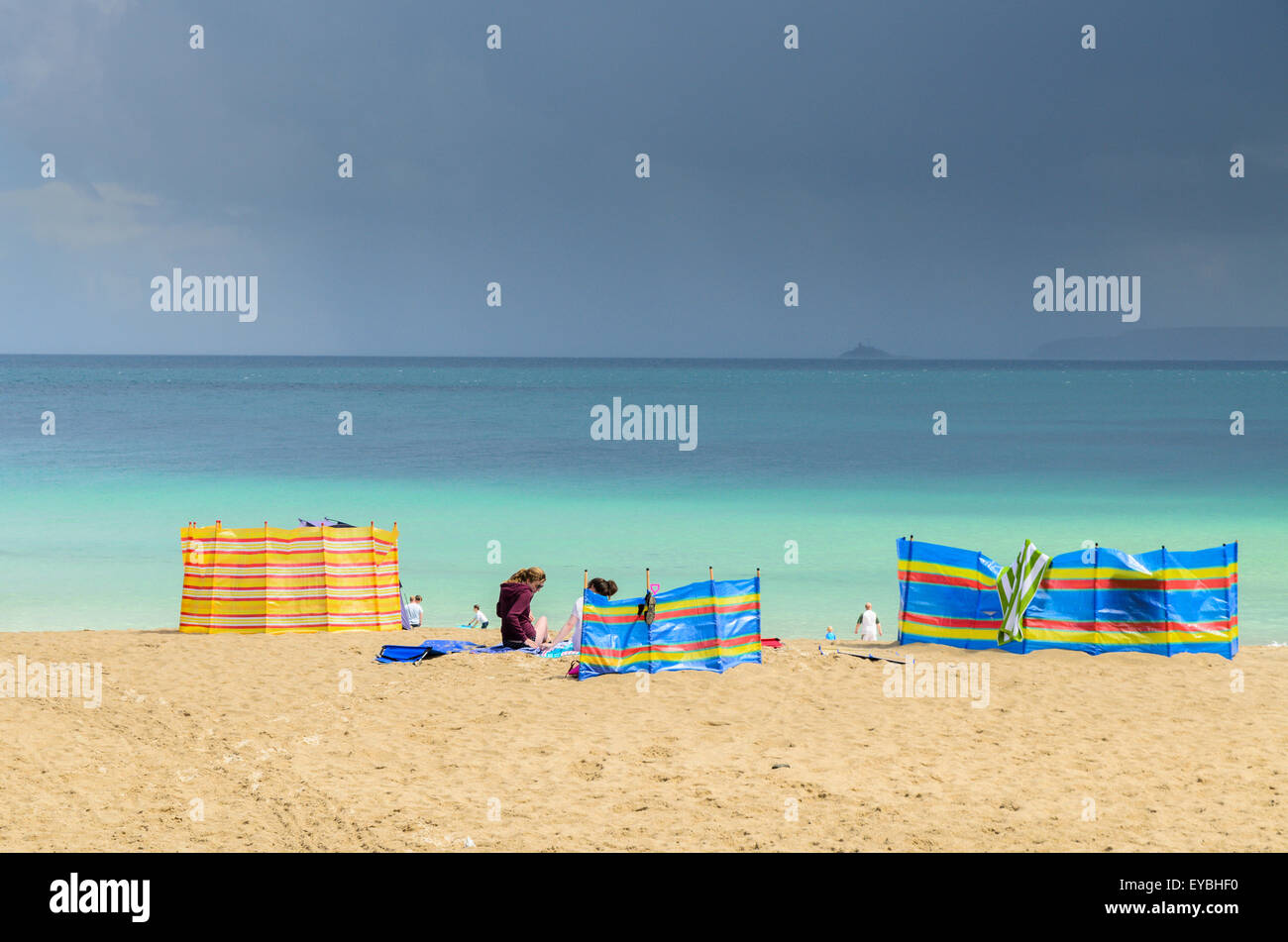 Holidaymakers on Porthgwidden Beach, St Ives, Cornwall, UK, Europe. - Stock Image