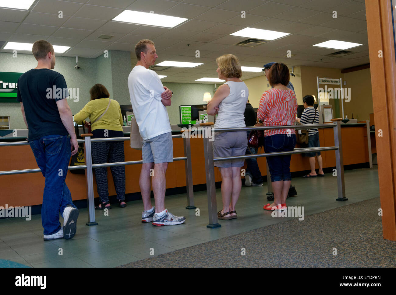 people-standing-in-a-bank-lineup-toronto