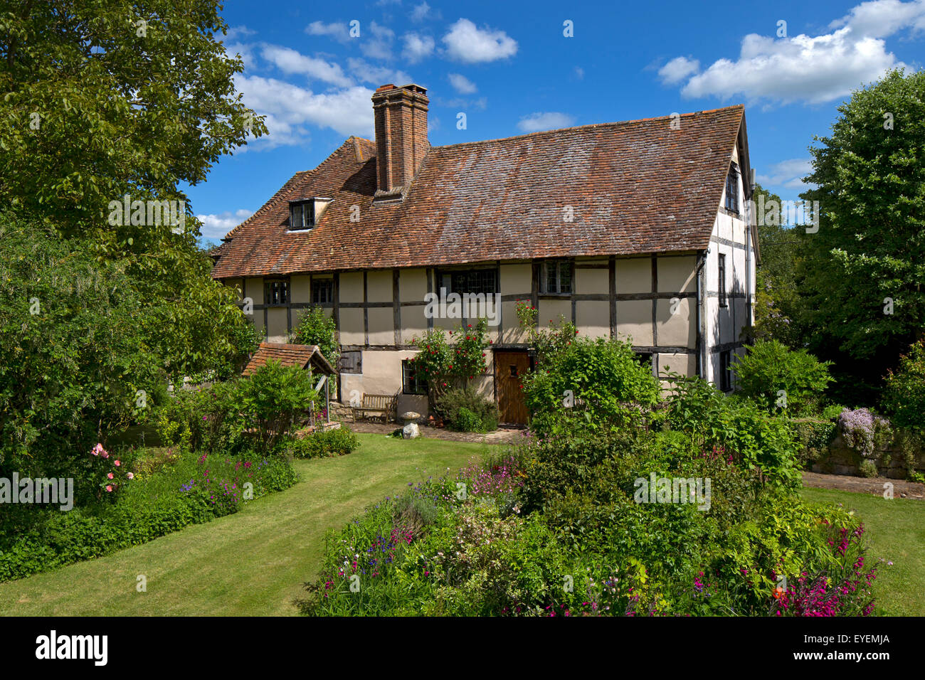Old English Manor house with summer flower Boarder - Stock Image