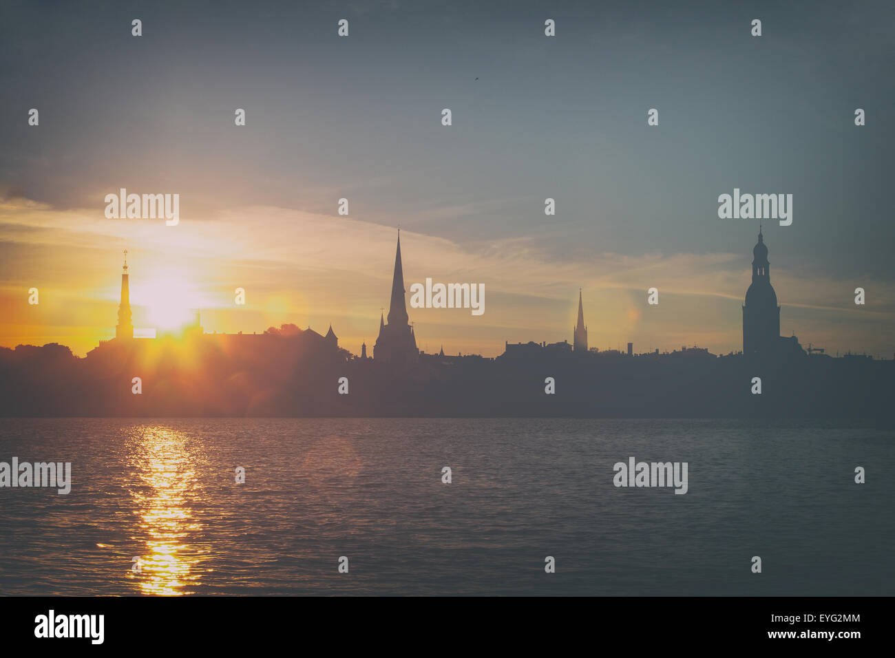 Stylized image of the sunrise over the palace of the President of Latvia and Riga in summer panorama - Stock Image