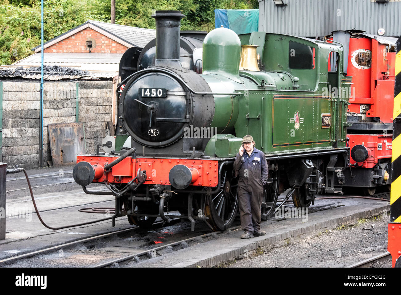 steam train engine number 1450 with Driver at severn valley railway in  Bridgnorth Shropshire
