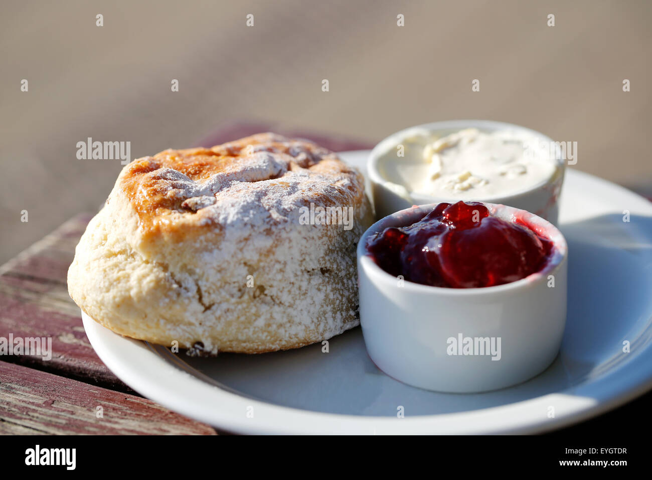 a-freshly-prepared-scone-with-jam-and-cr