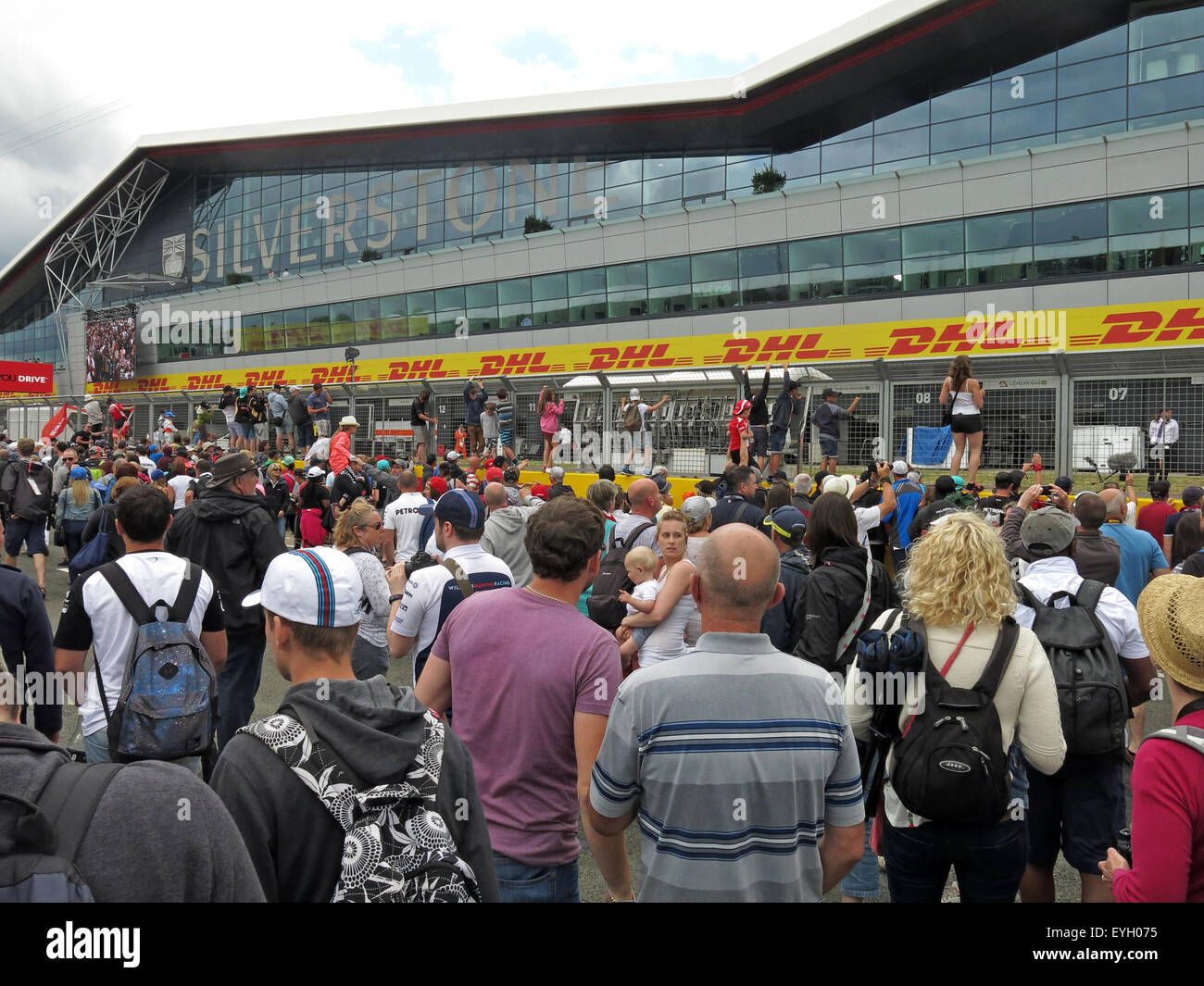 Formula1,formula,One,1,race,racing,circuit,car,motor,sport,motorsport,fan,fanatics,visitors,punters,road,track,side,trackside,podium,win,winner,winners,GB,English,sporting,event,calender,building,packed,full,ticketed,drive,driver,automobile,BTCC,fans,Formula One,Great Britain,crowds on track,GoTonySmith,wing,paddock,complex,2011,architecture,east,west,midlands,classic,facilities,home,of,motorracing,motoracing,venue,campers,northamptonshire,northants,officials,DHL,Buy Pictures of,Buy Images Of,Home Of British,Home,Of,British,Motor,Racing