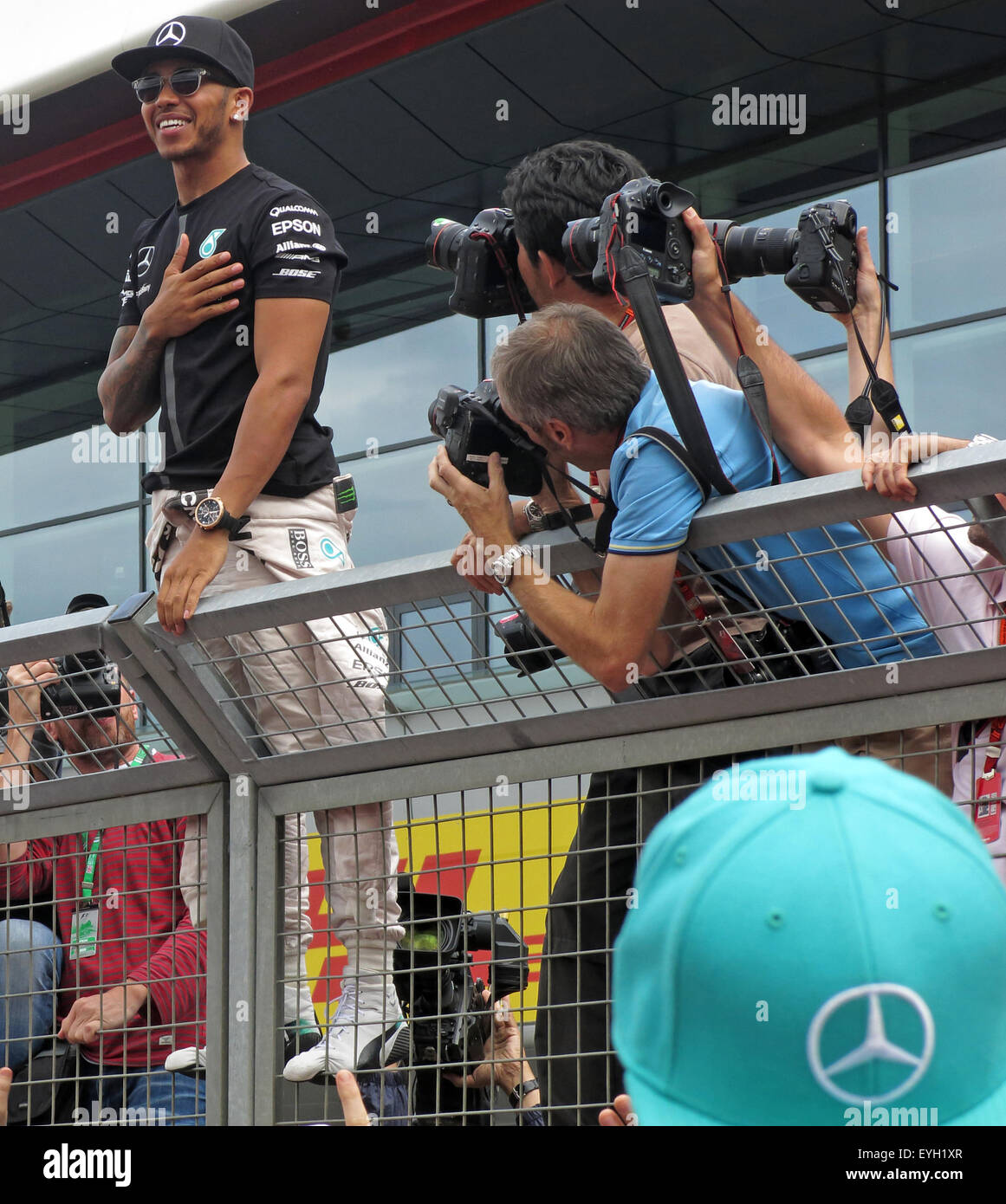 Lewis,Hamilton,standing,on,fence,camera,cameras,journalist,journalists,people,smiling,smiles,winner,racing,driver,Motorsport,motor,sport,GoTonySmith,Buy Pictures of,Buy Images Of