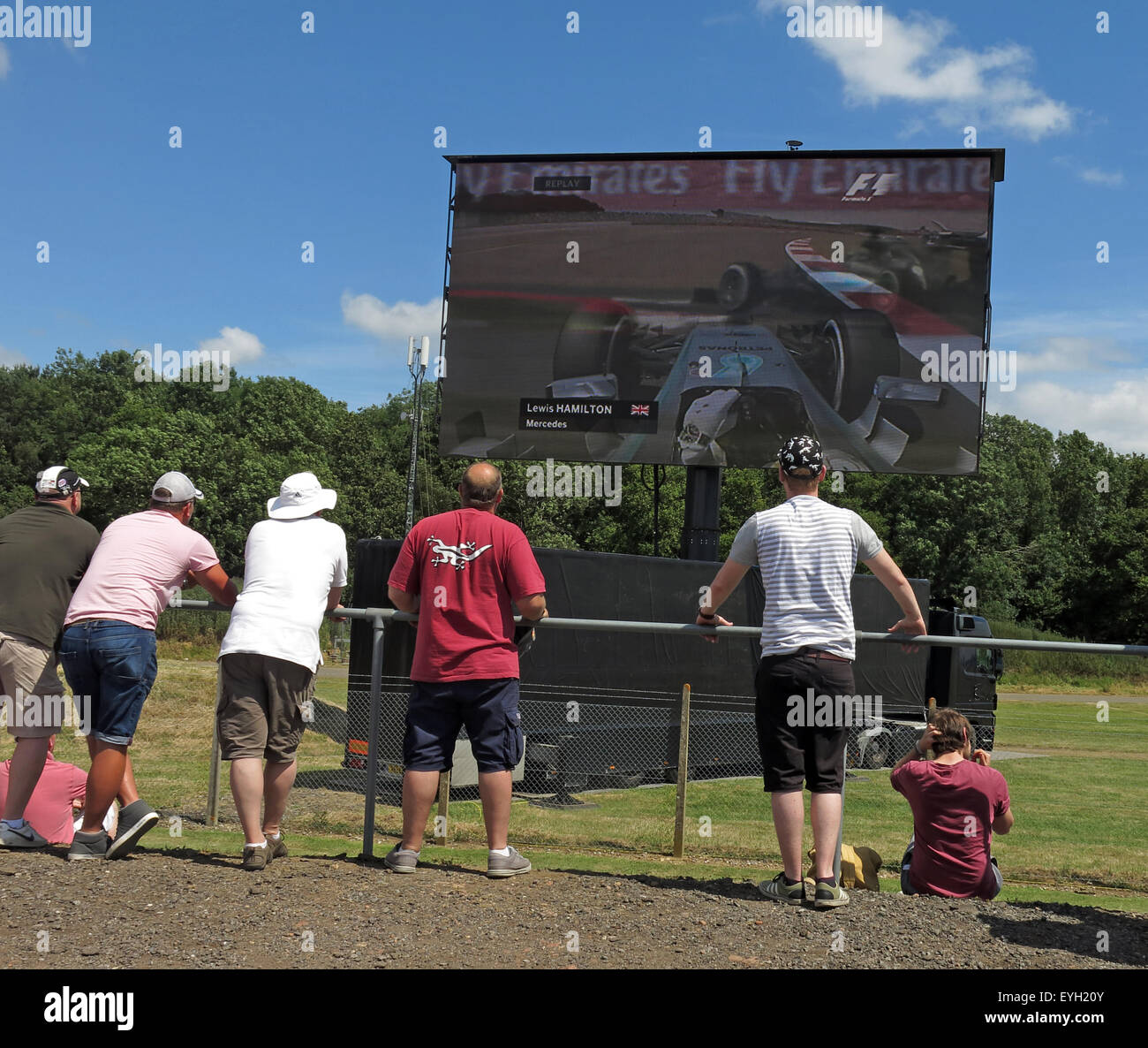 Formula,One,Great,Britain,sport,motor,motorsport,summer,car,cars,crowd,fans,racing,race,sun,fans,watching,Lewis,Hamilton,qualifying.on,a,large,screen,TV,Video,men,people,Lewis Hamilton,GoTonySmith,Buy Pictures of,Buy Images Of