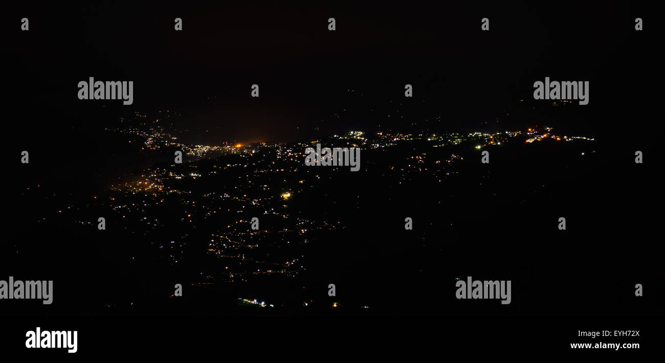 View of Kalimpong City of Himalayan hills during night with copy space - Stock Image