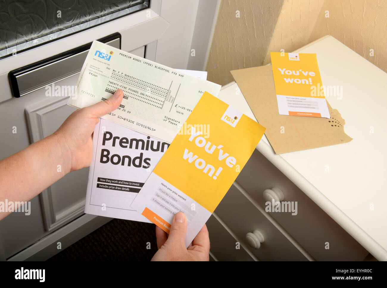 Premium Bonds win, Premium Bonds winner receives prize cheque in post, UK Stock Photo