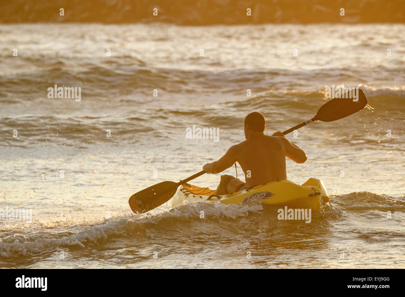 Man kayaking in surf at Ocean Beach, CA - Stock Image