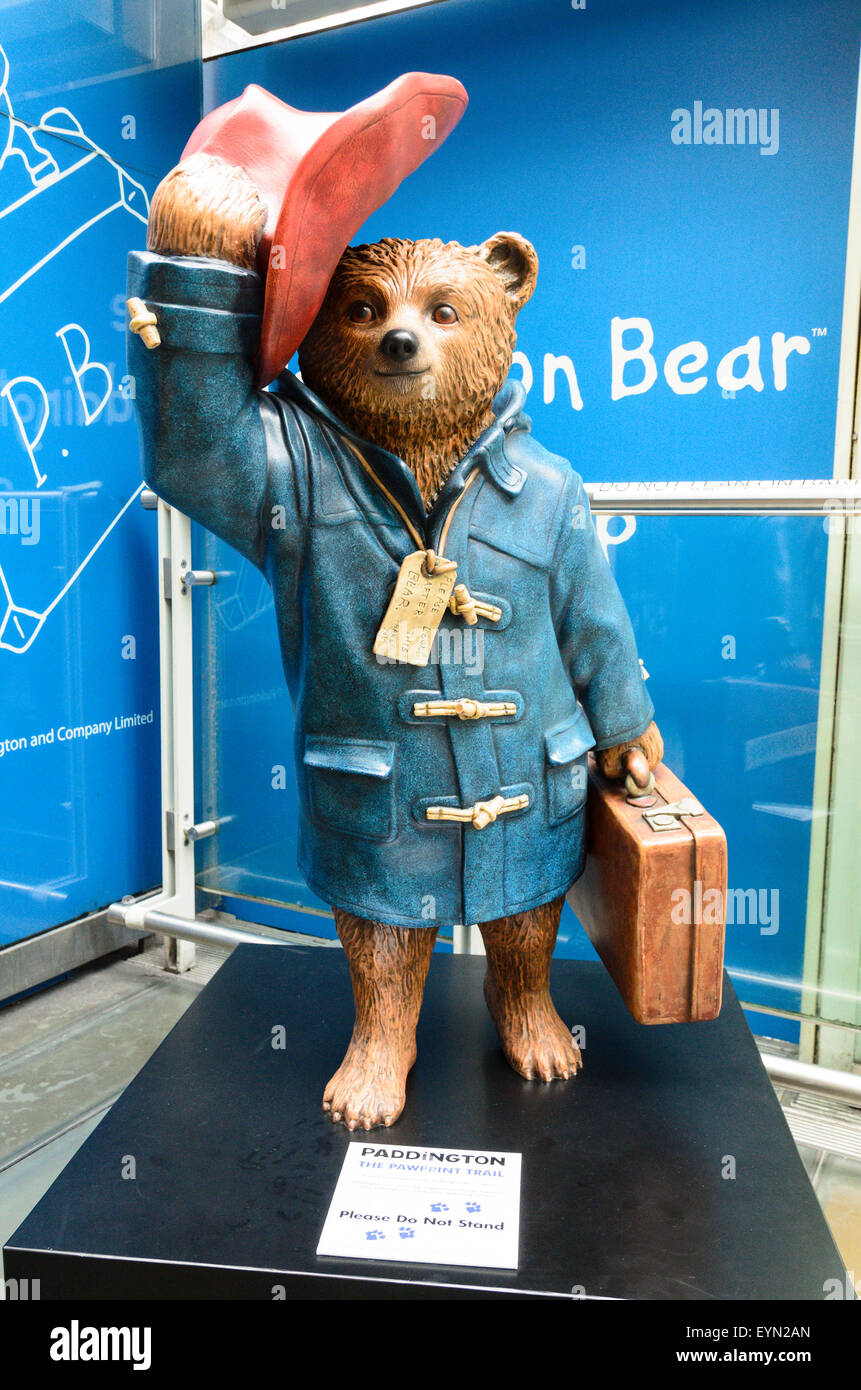 A statue of Paddington Bear at Paddington Station, London, England, UK - Stock Image