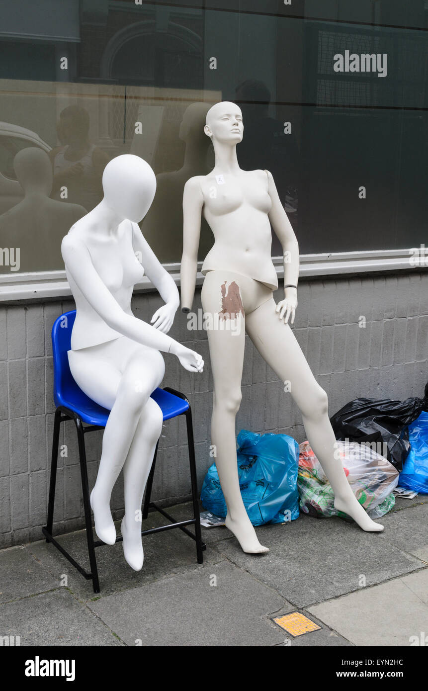 Disgarded shop mannequins outside a shop in London. - Stock Image