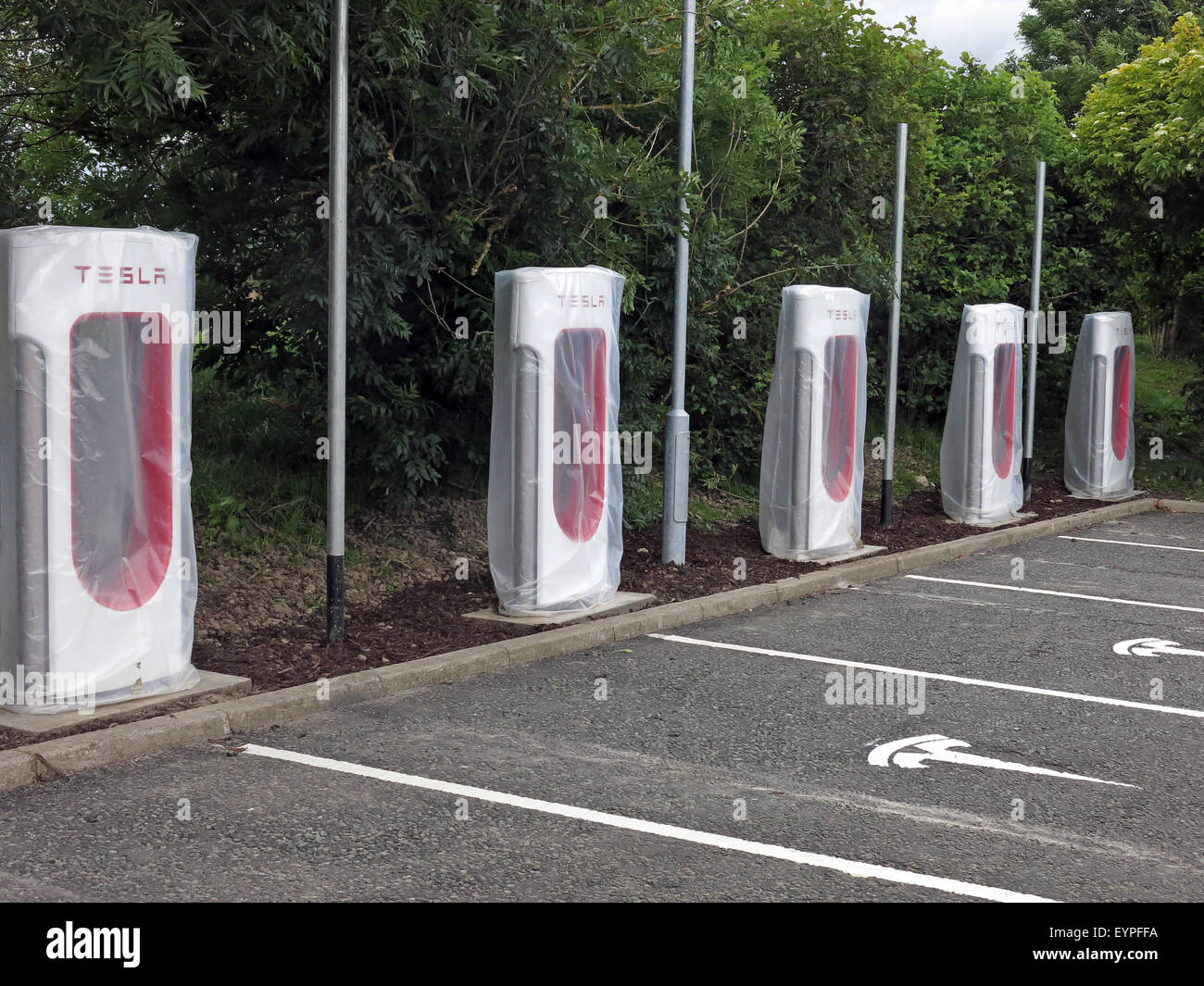 electric,car,cars,charger,chargers,area,motorway,service,area,in,the,UK,GB,Europe,eco,battery,powered,quick,station,electric,super,supercharge,supercharging,tesla,transport,transportation,united,us,USA,vehicle,M1,M2,M3,M4,M5,Electric car,United Kingdom,Great Britain,charging station,gotonysmith,sued,fight,rollout,highway,rest,stops,Moto,welcome,break,British,English,Scottish,Hybrid,Ecotricity,Group,providers,Antitrust,claim,Anti-trust,anti,trust,Tech,Vehicles,Palo Alto,California,Energy,white,ready,to,be,installed,part,part-installed,logo,tarmac,M74,M9,M60,M61,M62,M42,M11,M18,M20,M23,M26,M27,M32,M40,M48,M49,M50,M53,M54,M55,M56,M58,M69,M73,M80,M90,M602,M606,A1M,GoTonySmith,buy pictures of,roll out,roll-out,Tesla Motors Inc,Highway Rest Stops,Welcome Break,U.K.,Electric-car,clean energy,Buy Pictures of,Buy Images Of