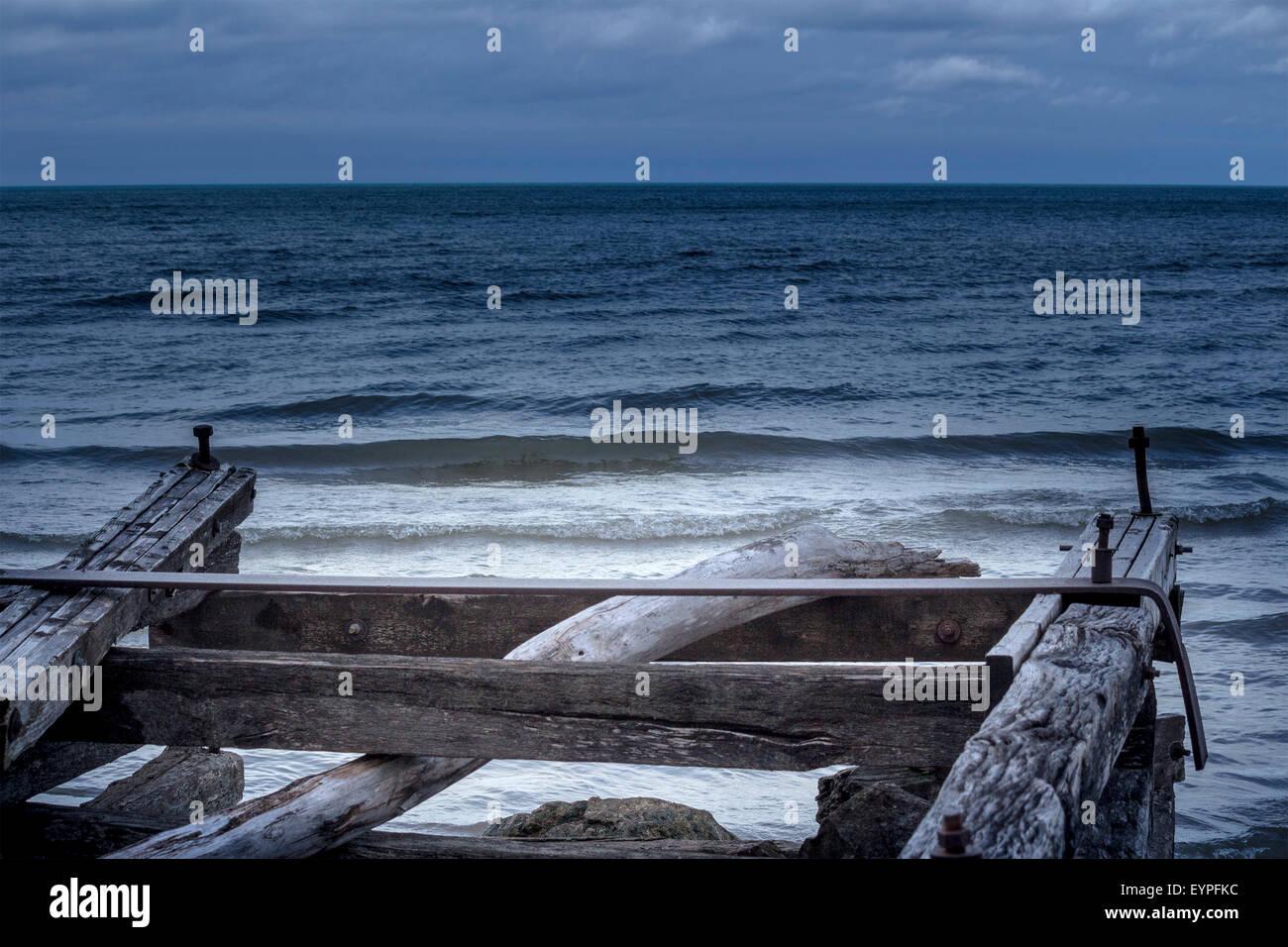 broken-dock-looking-out-to-sea-on-lake-huron-in-grand-bend-ontario-EYPFKC.jpg
