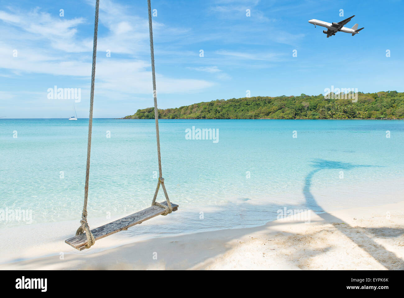Summer, Travel, Vacation and Holiday concept - Airplane arriving tropical beach sea in Phuket ,Thailand. - Stock Image