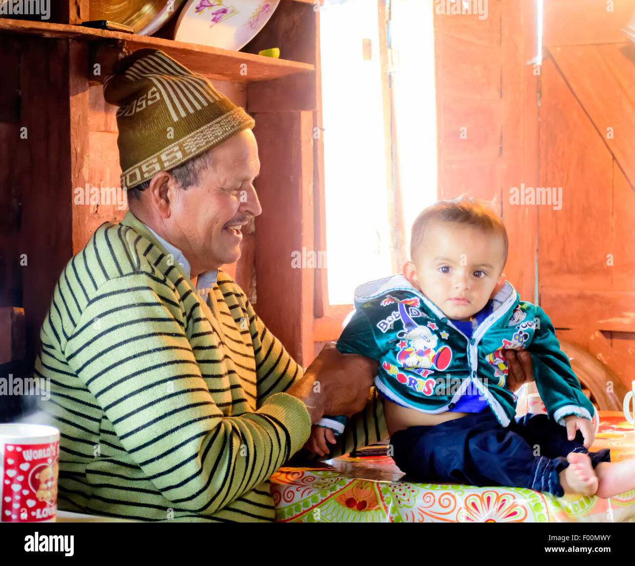 An old man playing with his grandson with copy space - Stock Image