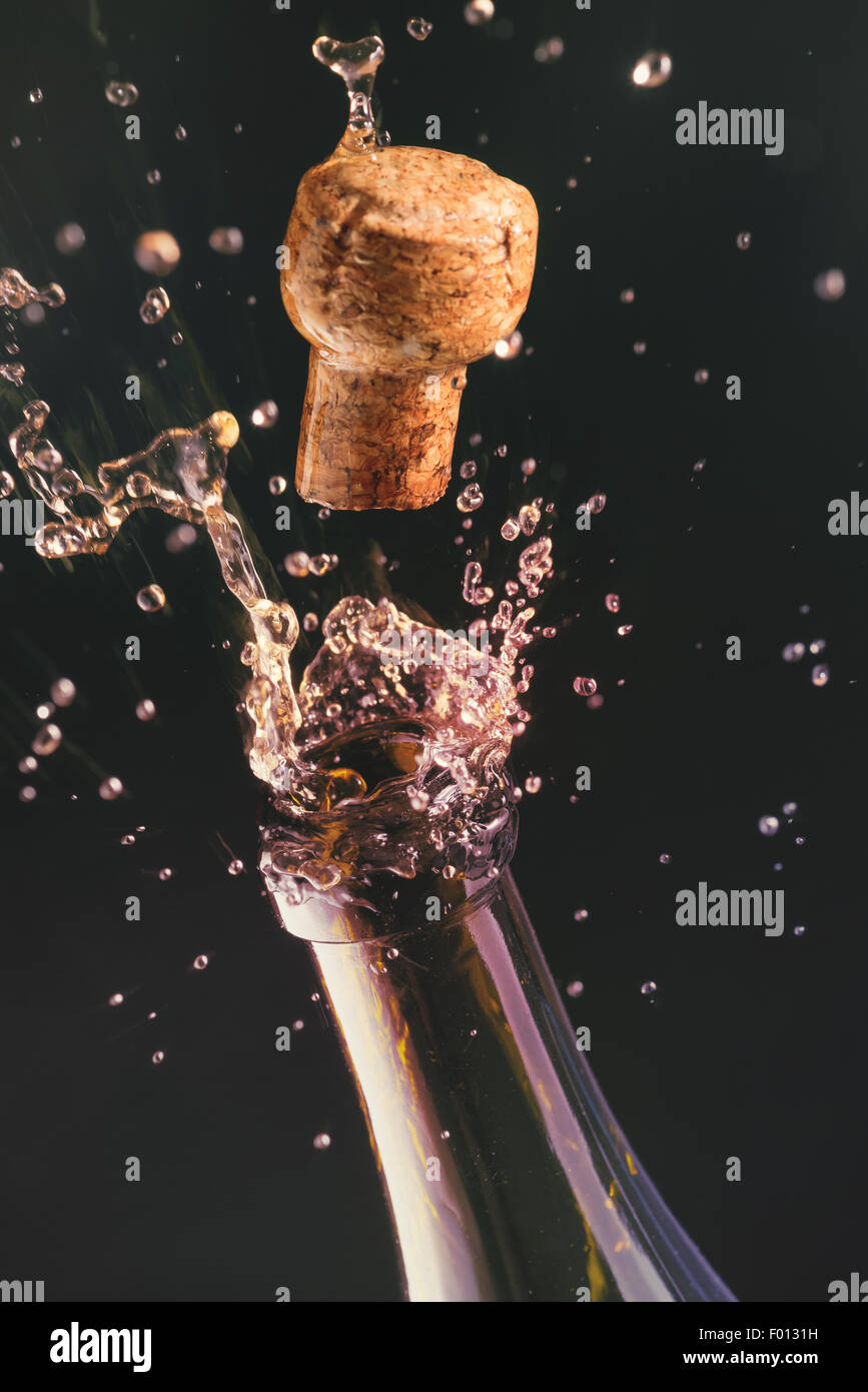 Opening a bottle of champagne. Celebration concept. - Stock Image