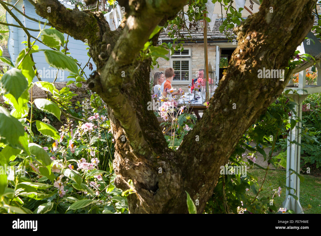 A lunch party in a quintessential English country garden in the ...