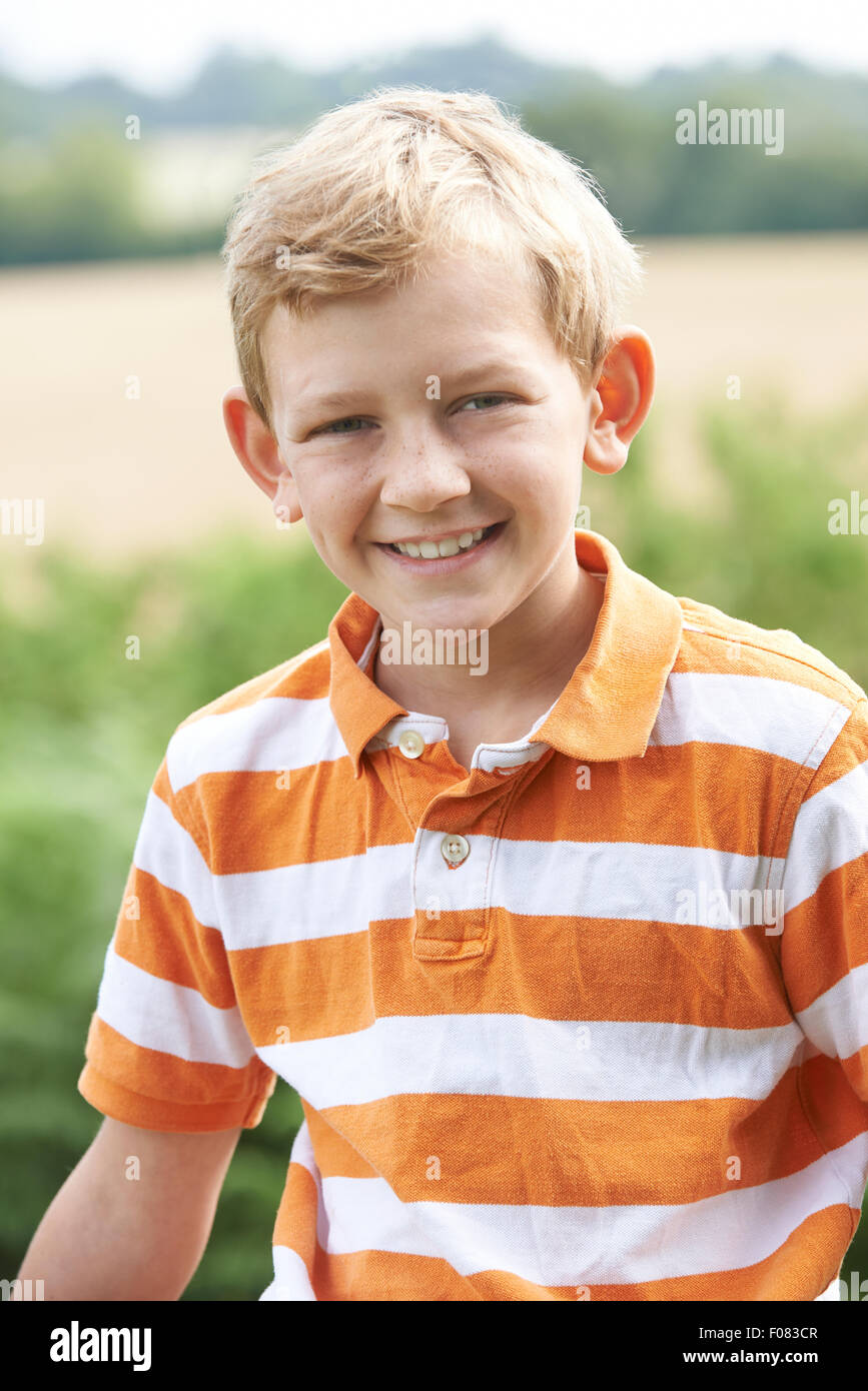Outdoor Head And Shoulder Portrait Of Boy - Stock Image