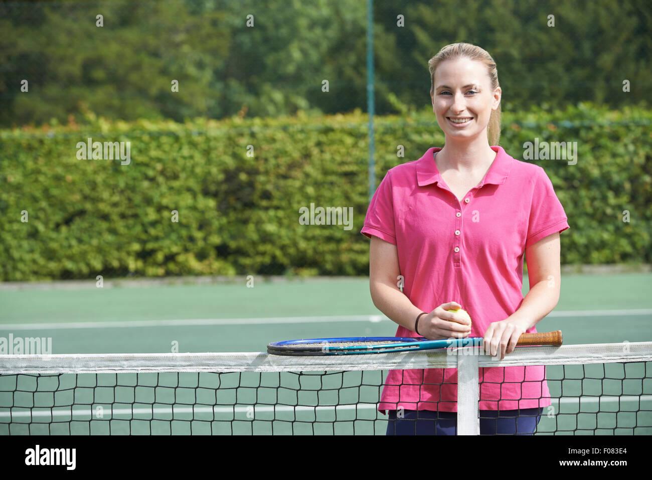 Portrait Of Female Tennis Coach On Court - Stock Image