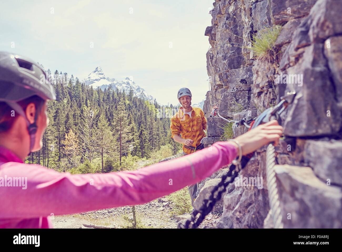 Couple rock climbing, Ehrwald, Tyrol, Austria - Stock Image