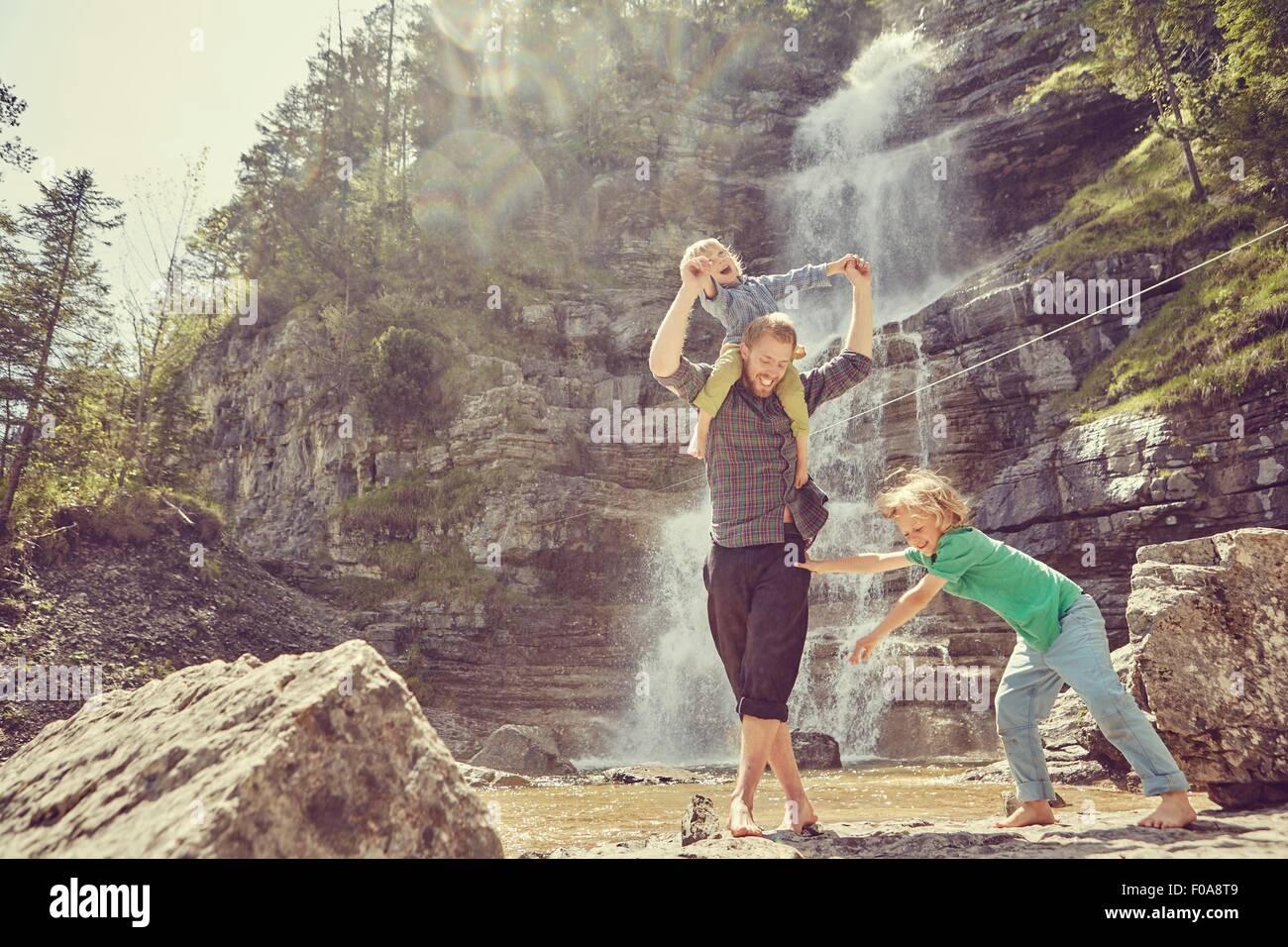 Two generation family having fun by waterfall, Ehrwald, Tyrol, Austria - Stock Image