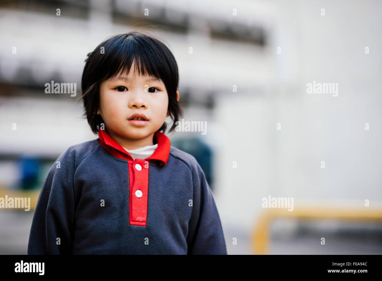 Portrait of boy looking at camera - Stock Image