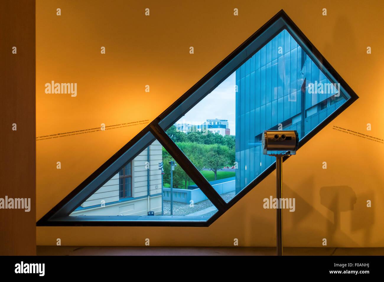 Berlin Jewish Museum Jüdisches Museum interior -  unusual angular window and view of garden - Stock Image