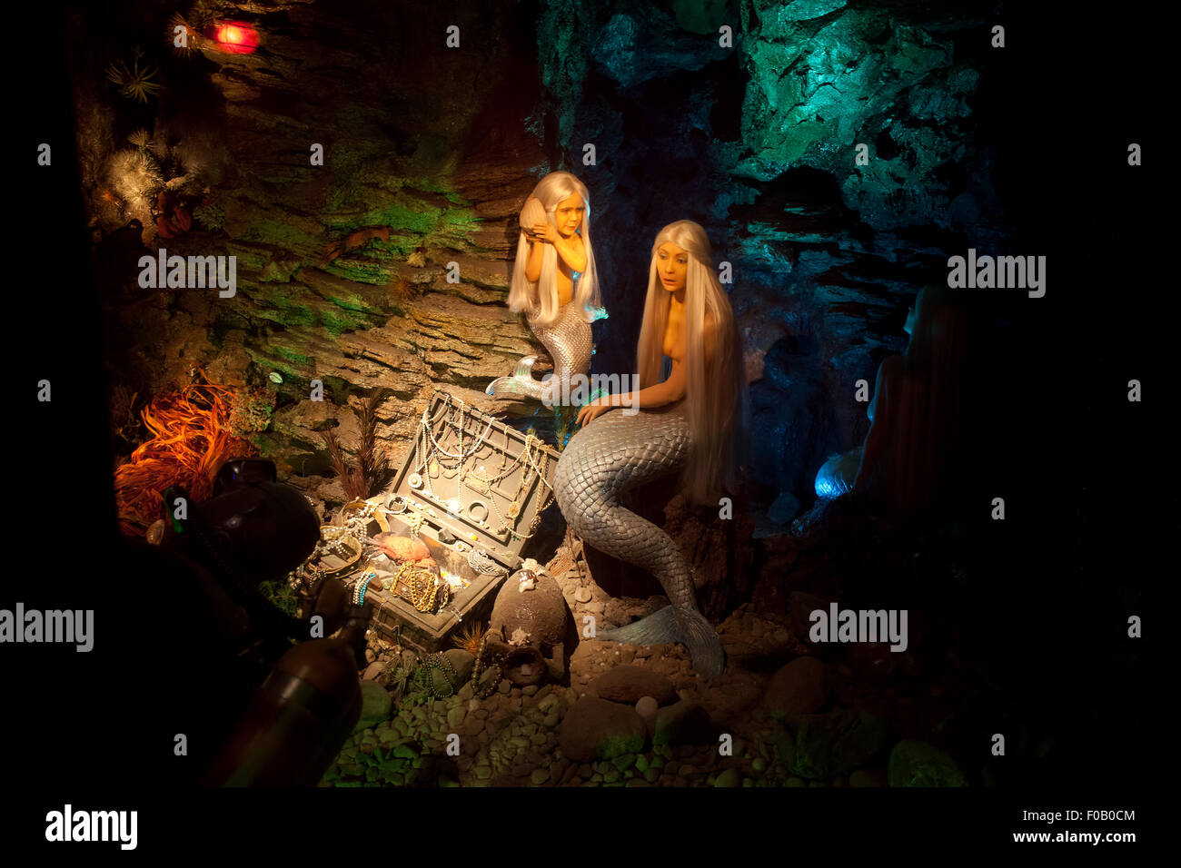 Mermaids or sirens with treasure chest full of jewels at the ocean bottom, Barcelona Wax Museum Museo de Cera, Catalonia, - Stock Image