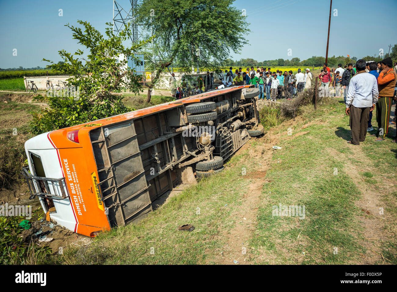 Crashed bus on the roadside between Khajuraho and Chitrakut in India - Stock Image