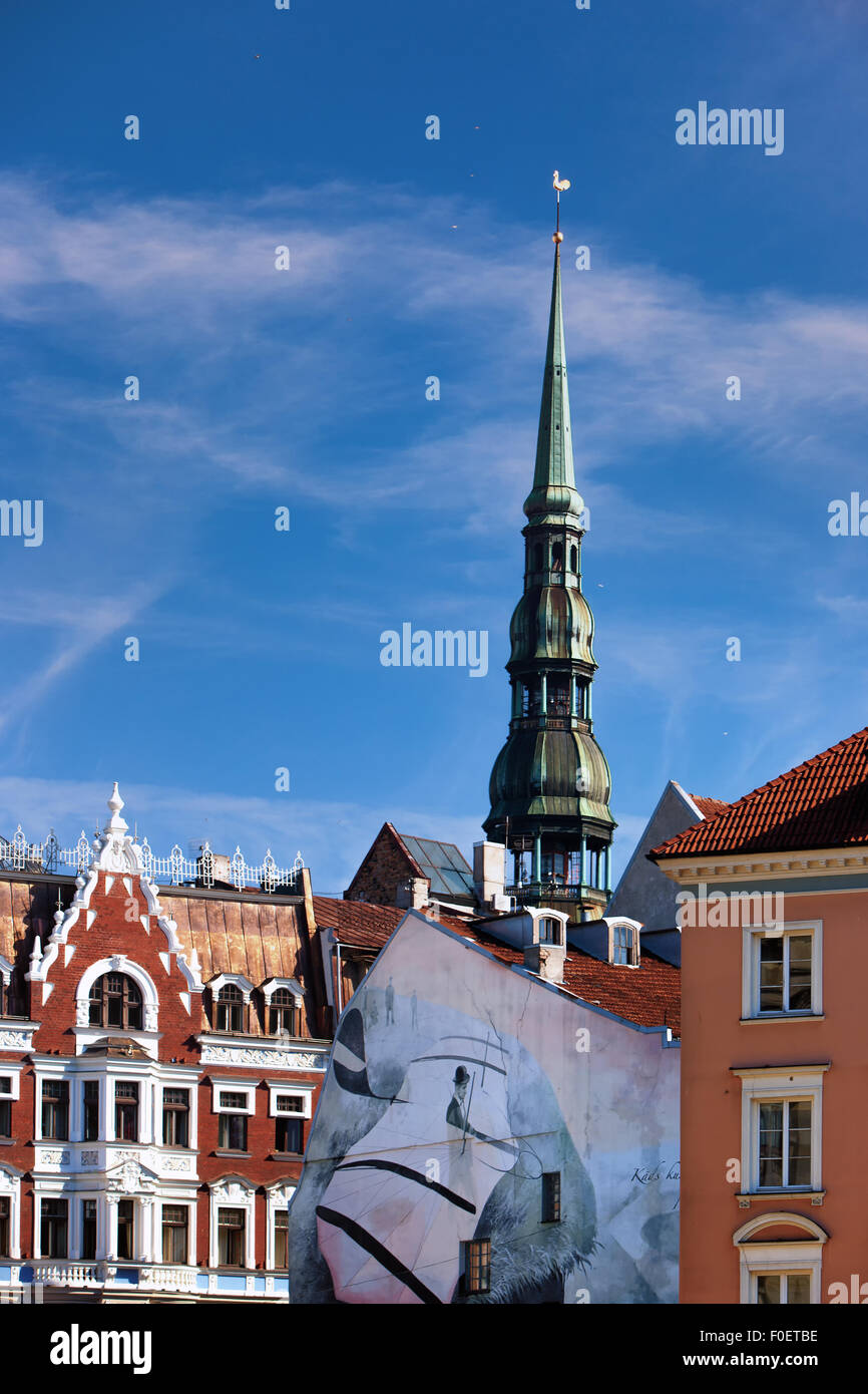 Latvia. The spire of a cockerel St. Peter's Church and the medieval buildings in Riga, Dome Square - Stock Image