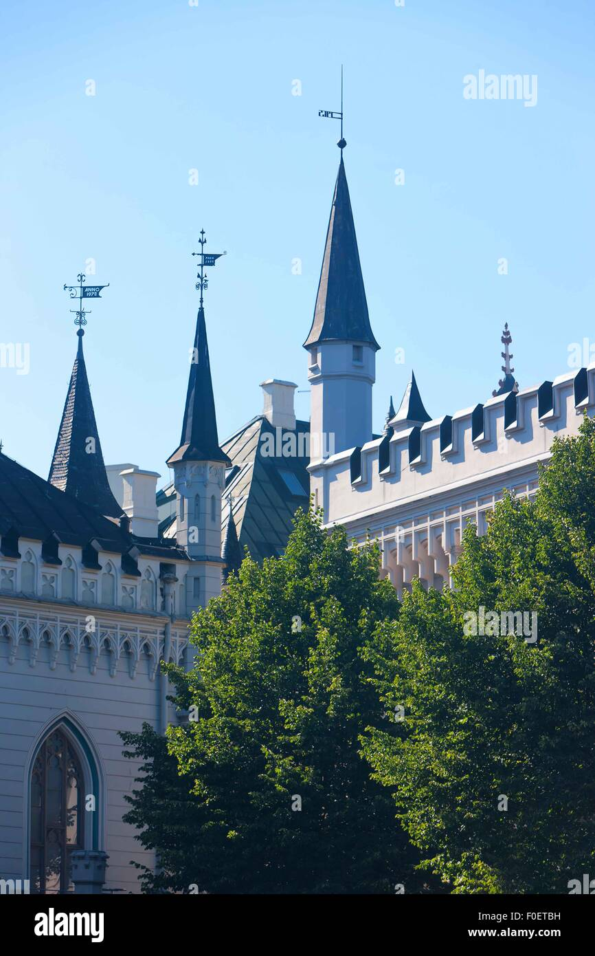 Latvia. The spiers of a weathervane on the small and large guilds in Riga in summer day - Stock Image