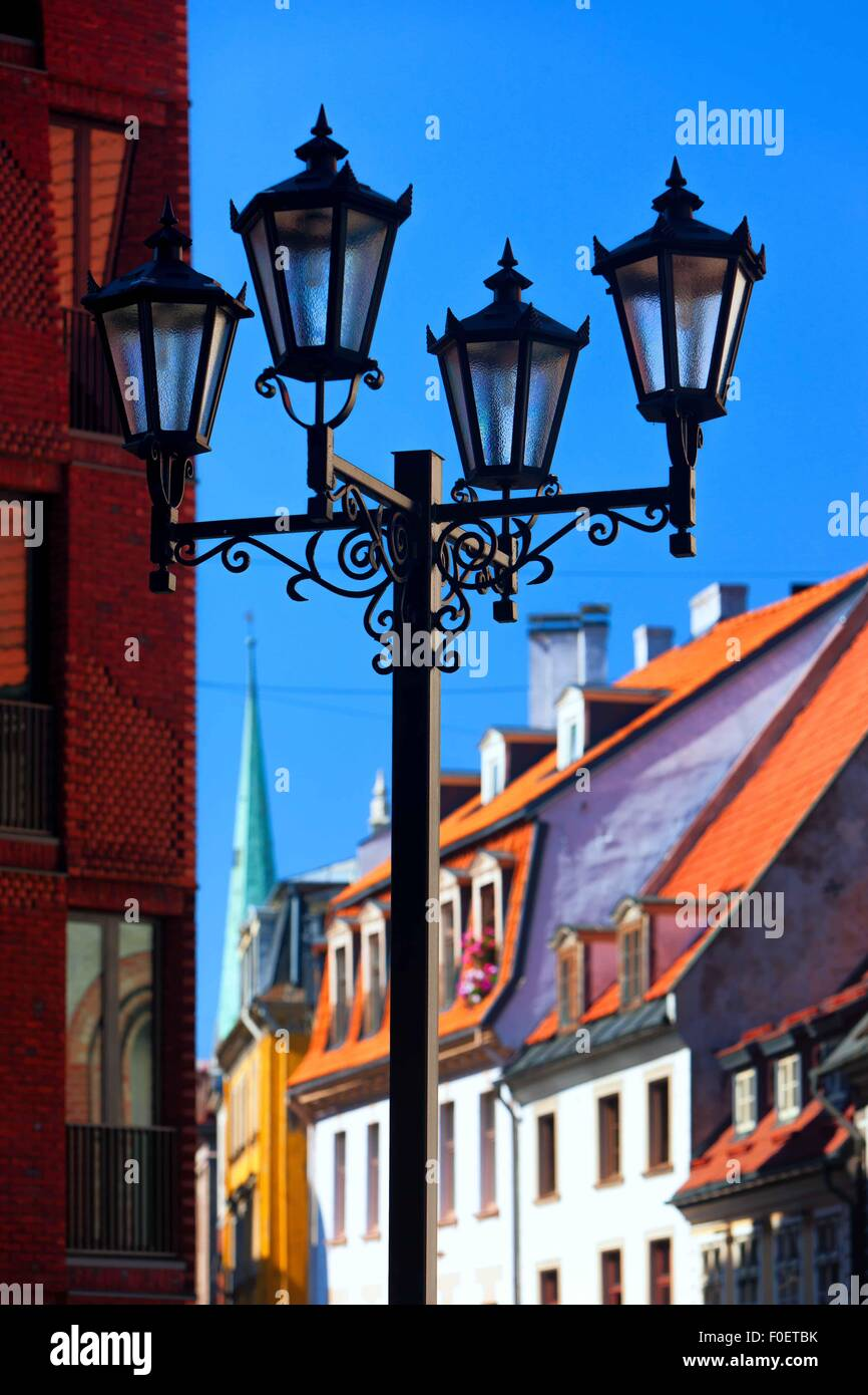 Latvia. High street light on the background of the facades and roofs of the old city of Riga on a sunny summer day - Stock Image