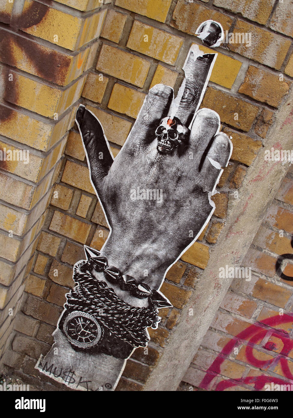 Mitte,DircksenStr,Berlin,Germany,streetArt,artist,of,the,streetsmixedmedia,mixed,media,poster,paper,wall,walls,city,cities,urban,hipster,controversial,paste,up,pasteup,watch,arm,extended,middle,finger,skull ring,skullring,Skull ring,GoTonySmith,Deutsche,Deutschland,Buy Pictures of,Buy Images Of