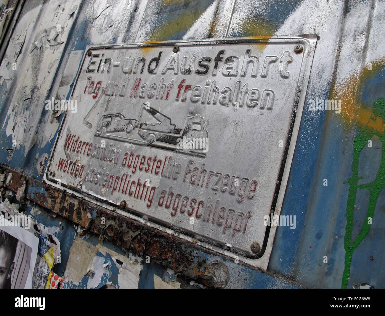 Mitte,DircksenStr,Berlin,Germany,streetArt,artist,of,the,streetsmixedmedia,mixed,media,poster,paper,wall,walls,city,cities,urban,hipster,controversial,Ein-und,EinUnd,Ausfahrt,parking,towaway,tow,away,sign,covered,in,paint,painted,spray,sprayed,GoTonySmith,Deutsche,Deutschland,Buy Pictures of,Buy Images Of
