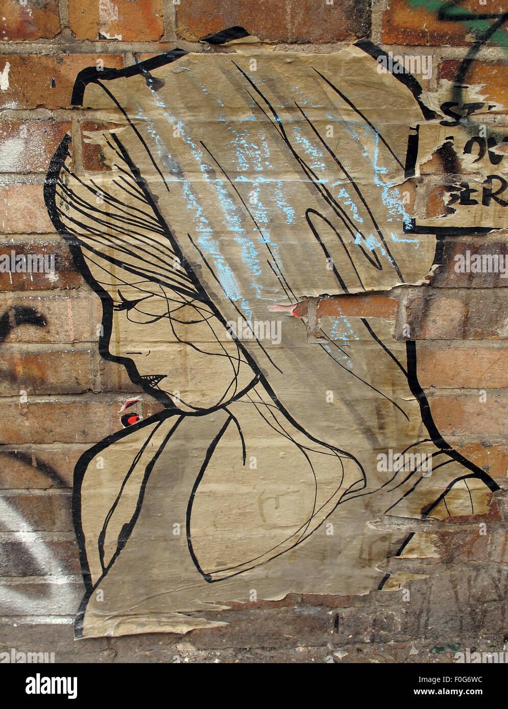 Mitte,DircksenStr,Berlin,Germany,streetArt,artist,of,the,streetsmixedmedia,mixed,media,poster,paper,wall,walls,city,cities,urban,hipster,controversial,paste,up,pasteup,Girl,in,a,shawl,GoTonySmith,Deutsche,Deutschland,Buy Pictures of,Buy Images Of
