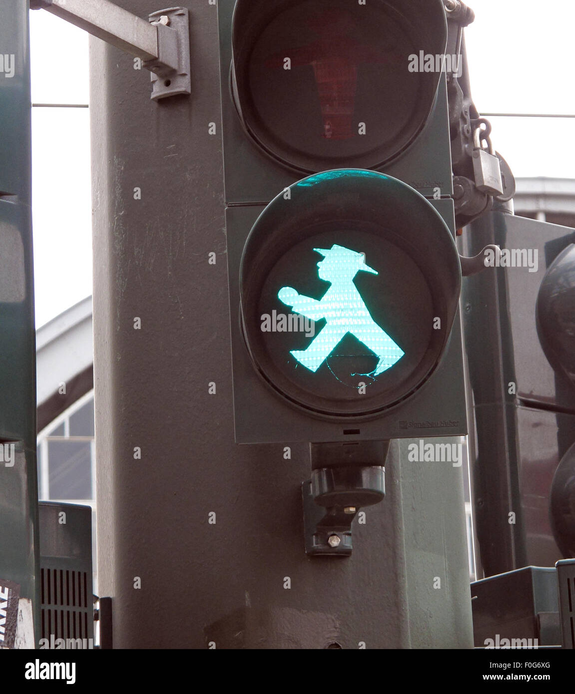 ampelmann,ampelmannchen,berlin,blue,city,cloud,color,control,crossing,crossroads,ddr,deutschland,east,europe,european,famous,figure,funny,gdr,german,germany,go,green,illuminated,intersection,lamp,light,man,manikin,mass,original,pedestrian,post,public,green,road,GoTonySmith,classic,unique,Euro,roads,sign,sky,street,traffic,transit,transport,transportation,travel,trip,urban,walker,walking,Buy Pictures of,Buy Images Of