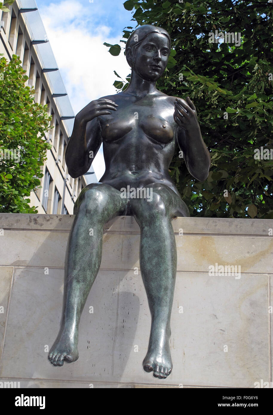 3,Statue,by,the,Spree,River,Moabit,Berlin,Germany,bronze,bank,side,of,art,artist,public,publicart,German,sculptor,DomAquarée,DomAquaree,summer,sunny,bright,city,cities,culture,front,view,frontal,GoTonySmith,Buy Pictures of,Buy Images Of
