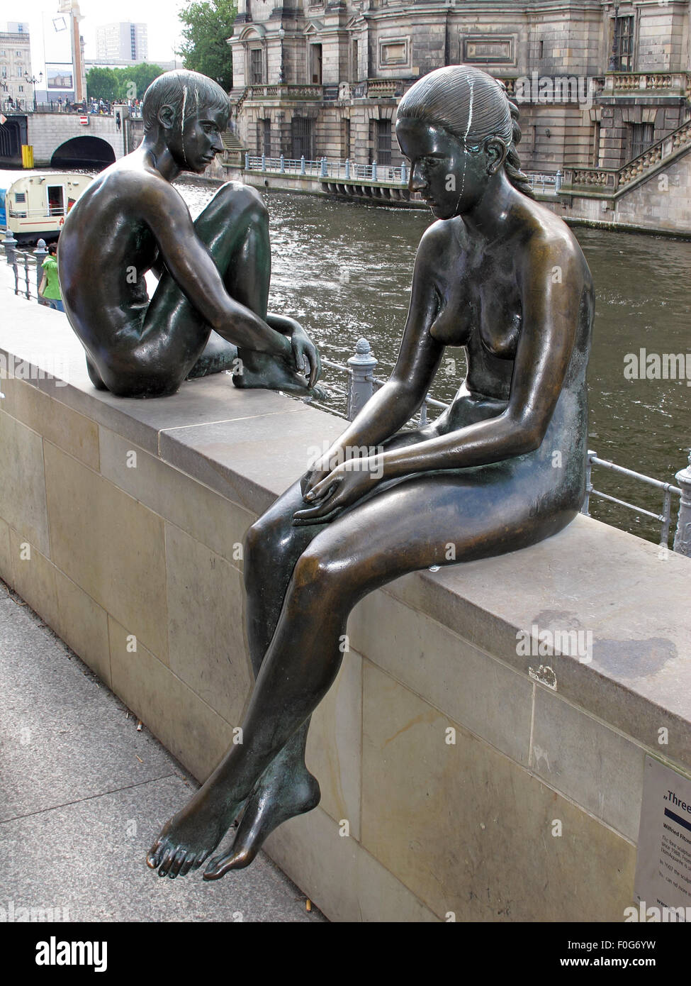 3,Statue,by,the,Spree,River,Moabit,Berlin,Germany,bronze,bank,side,of,art,artist,public,publicart,German,sculptor,DomAquarée,DomAquaree,summer,sunny,bright,city,cities,culture,side,view,sideview,sit,sitting,GoTonySmith,Buy Pictures of,Buy Images Of