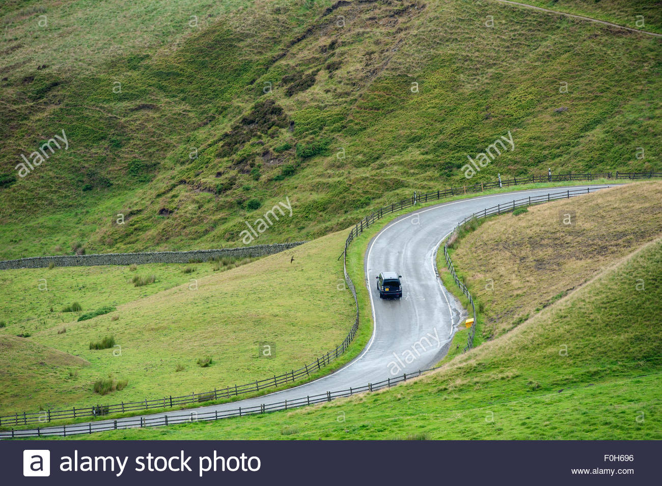 Edale Derbyshire UK. S-bend on a rural road passing through the Peak District National Park - Stock Image
