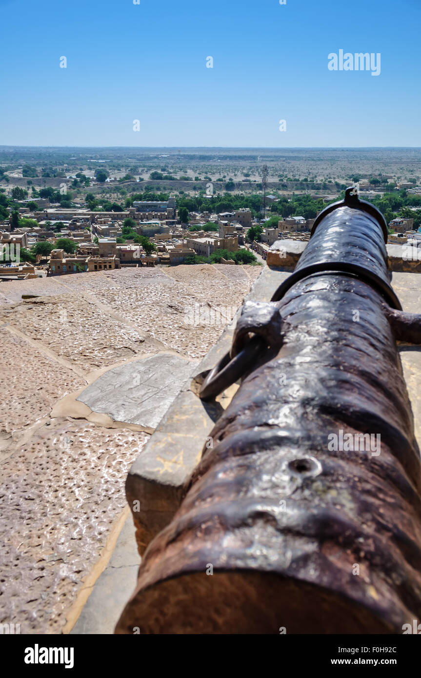 Ancient iron cannon of Golden Fort of Jaisalmer, Rajasthan India facing Jaisalmer city with copy space - Stock Image