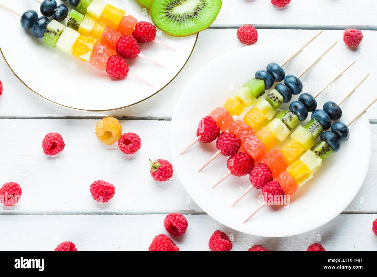 Fresh summer fruits on sticks - Stock Image