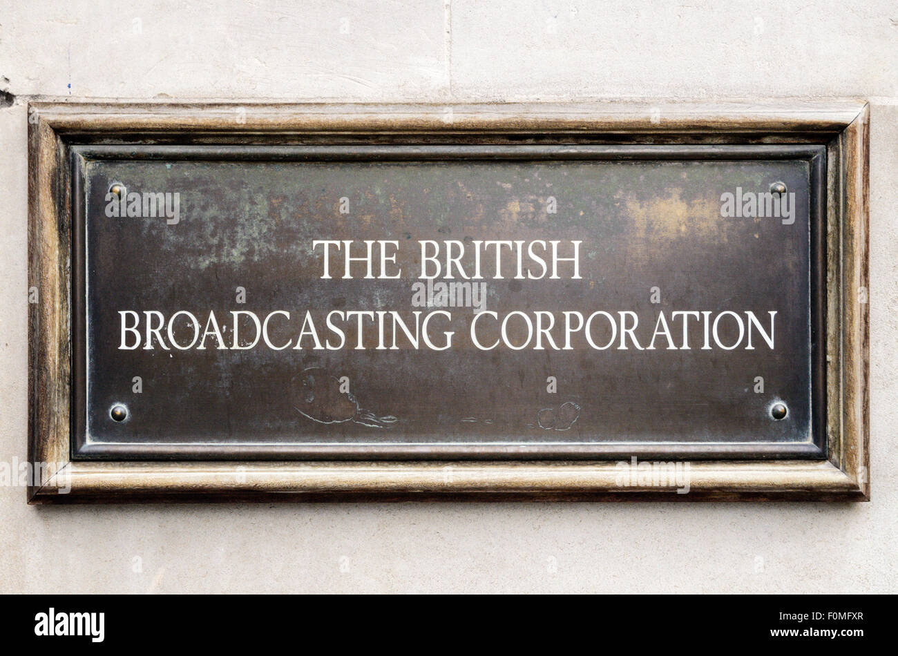 The sign for The British Broadcasting Corporation on the wall of Broadcasting House, Langham Place, London, England, - Stock Image