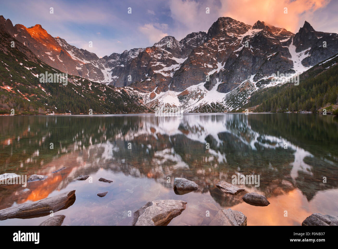 The Morskie Oko mountain lake in the Tatra Mountains in Poland, photographed at sunset. - Stock Image