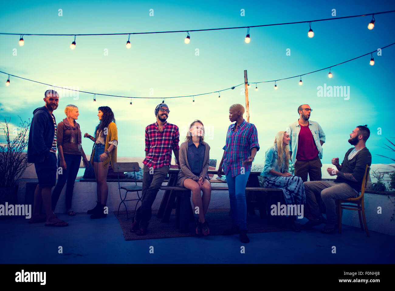 Diversity Sundown Beach Chatting Roof Top Fun Concept - Stock Image