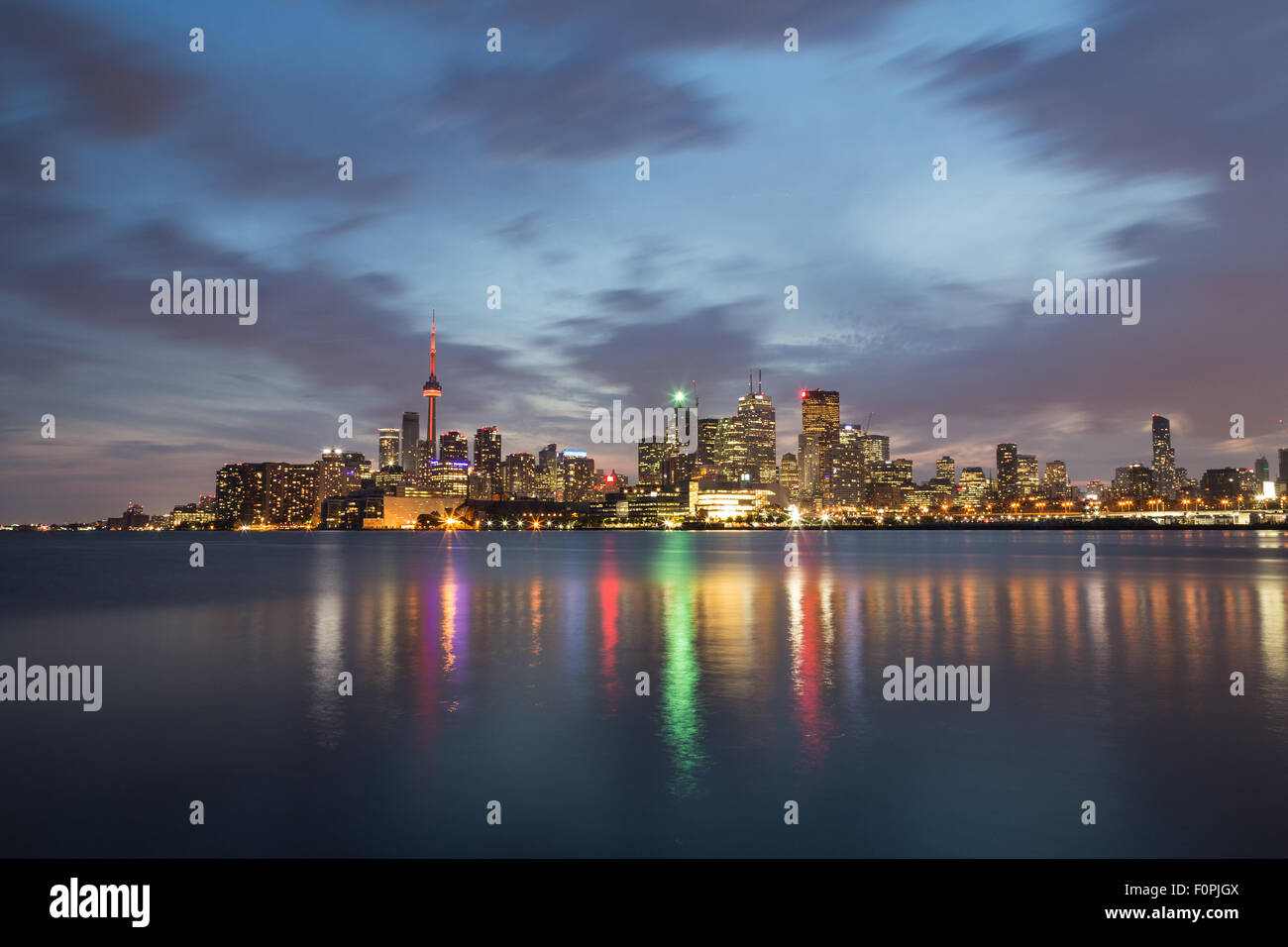 The Toronto Skyline at Night showing buildings and reflections in Lake Ontario - Stock Image